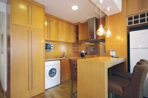 A kitchen or kitchenette at Vivaldi Penthouse Ayuntamiento