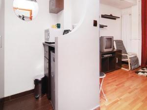 O bucătărie sau chicinetă la NEC Accommodation