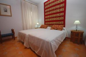 A bed or beds in a room at Rincones con Luz Suabia