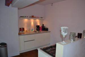 A kitchen or kitchenette at Dols Apartment