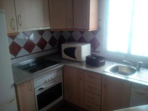A kitchen or kitchenette at Apartamento centro historico