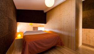 A bed or beds in a room at Vale do Ninho Houses