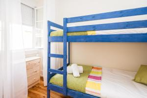 A bunk bed or bunk beds in a room at ShortStayFlat Lisbon Soul