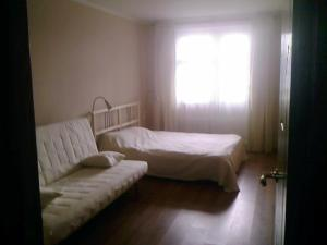 A bed or beds in a room at Apartment Allinrent Voykovskaya