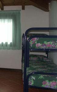 A bunk bed or bunk beds in a room at Villa Kandinskij