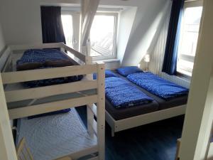Ein Etagenbett oder Etagenbetten in einem Zimmer der Unterkunft Appartementen Zandvoort
