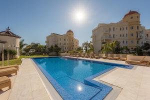 The swimming pool at or near Las Dunas Suites & Apartments