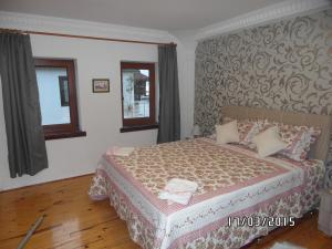 Gulta vai gultas numurā naktsmītnē Beach House Apartment
