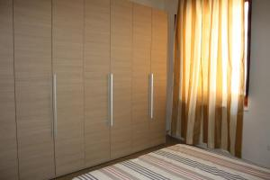 A bed or beds in a room at Vicodieci Stampace