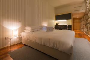 A bed or beds in a room at Porto de Rio