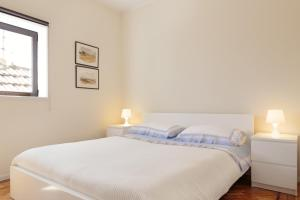 A bed or beds in a room at Fabrica Lux Apart