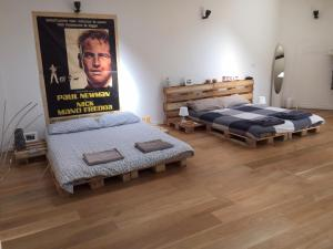 A bed or beds in a room at Tommy Loft