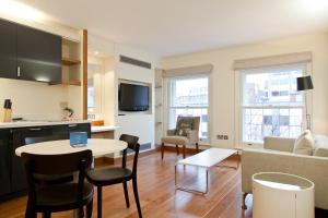 A television and/or entertainment center at Blueprint Living Apartments -Turnmill Street