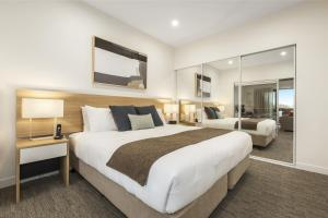 A bed or beds in a room at Quest Nowra