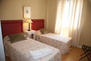 A bed or beds in a room at Macarena Flat