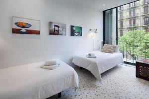 A bed or beds in a room at Habitat Apartments Pedrera