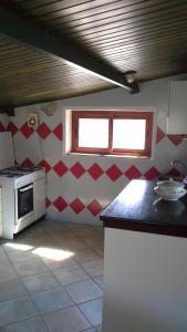 A kitchen or kitchenette at Arbatax Attico Rocce Rosse