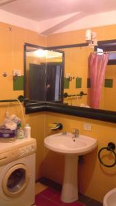 A bathroom at Arbatax Attico Rocce Rosse
