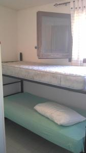 A bunk bed or bunk beds in a room at Arbatax Attico Rocce Rosse