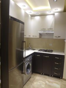A kitchen or kitchenette at Studio-Apartment Komitas