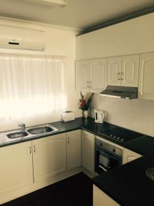 A kitchen or kitchenette at Madalena Holiday Apartments