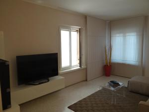 A television and/or entertainment center at Theater Verona Apartment