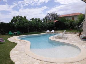 The swimming pool at or near Guesthouse Villa Lena