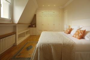 Cama o camas de una habitación en Miramar Apartment by FeelFree Rentals