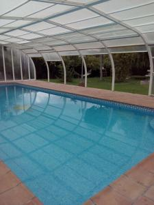 The swimming pool at or near casa chalet El Sotillo