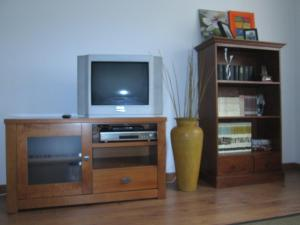 A television and/or entertainment center at Al Rincon de Emi