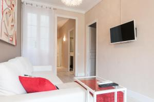A bed or beds in a room at Boutique Apartment Sagrada Familia