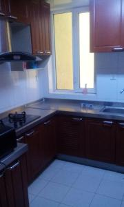 A kitchen or kitchenette at Beijing Yanyan Student Apartment