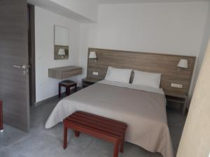 A bed or beds in a room at Epiphany Apartments