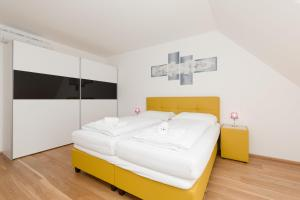 A bed or beds in a room at Yourapartment 1020