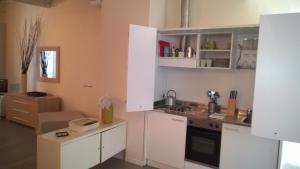 A kitchen or kitchenette at Agorà Residenza