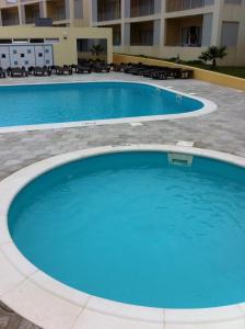 Swimming pool sa o malapit sa Paraiso Dourado