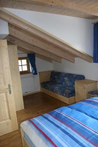A bed or beds in a room at Valtnerhof