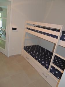 Un ou plusieurs lits superposés dans un hébergement de l'établissement Gite Opale Saint Saens