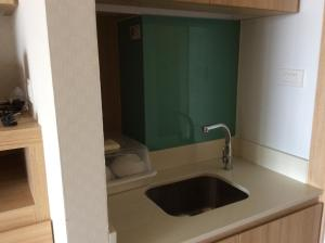 A kitchen or kitchenette at Himawari at Kanyarat Condo