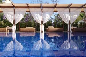 The swimming pool at or near Viva Blue & Spa