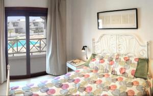 A bed or beds in a room at Casa Nimbara