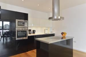 A kitchen or kitchenette at Farringdon Superior Apartments