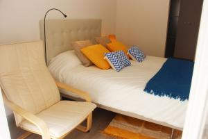A bed or beds in a room at Lisbon Roots - Apartments