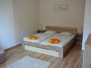 A bed or beds in a room at Ernesta Club Lipno