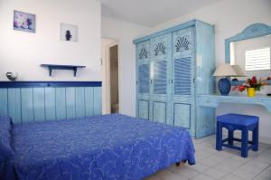 A bed or beds in a room at Résidence Tropicale