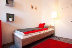 Кровать или кровати в номере Ostrovni Apartment