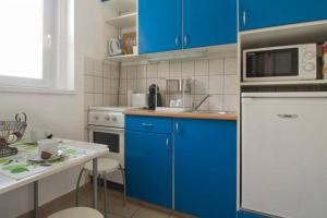 A kitchen or kitchenette at Apartment Heart Of Budapest