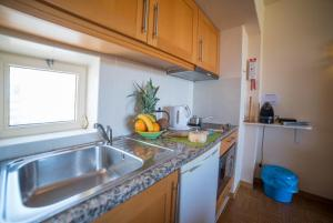 A kitchen or kitchenette at Luz Beach Apartments