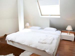 A bed or beds in a room at VISIONAPARTMENTS Zurich Waffenplatzstrasse