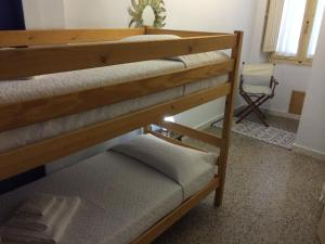 A bunk bed or bunk beds in a room at Appartamento Cagliari Centro